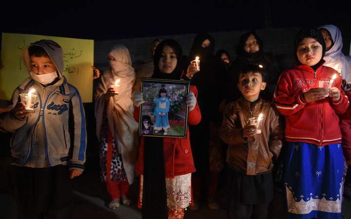 Pakistani members of the Hazara community hold a vigil in tribute to Zainab