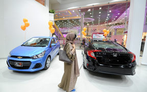 Saudi women tour a car showroom for women.