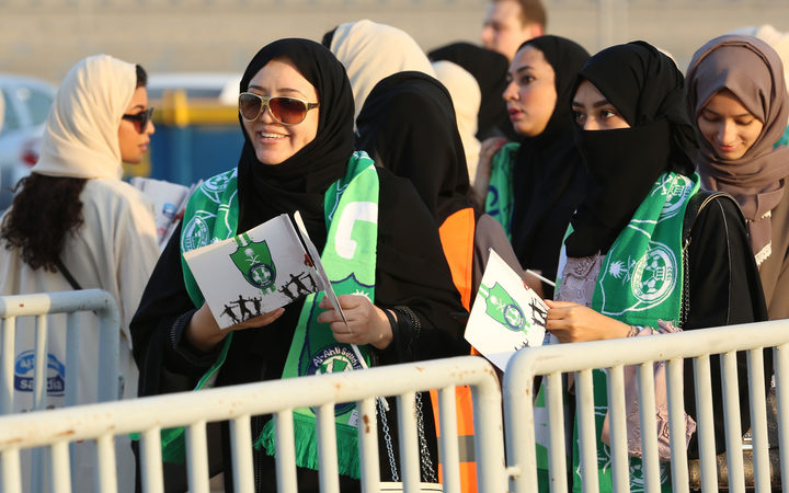 Female Saudi supporters of Al Ahli queue at an entrance for families and women at the King Abdullah Sports City