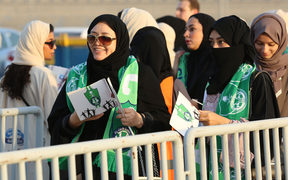 Female Saudi supporters of Al-Ahli queue at an entrance for families and women at the King Abdullah Sports City