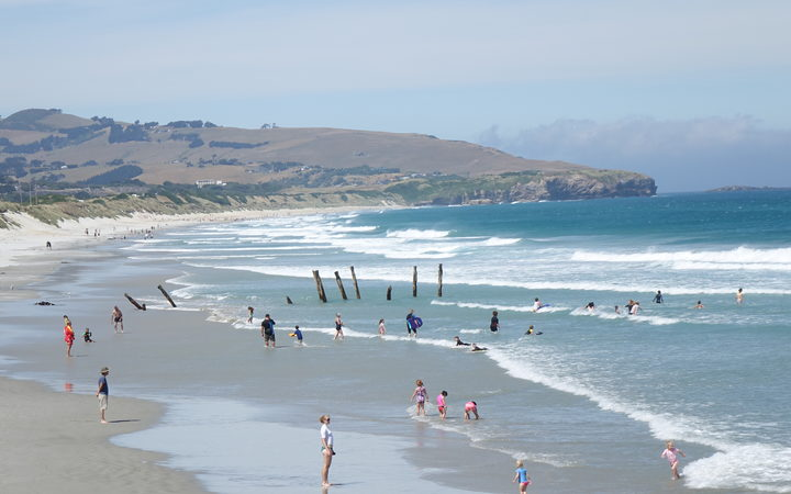 Dunedin residents took to St Clair Beach to get out of the heat of the day.