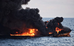 "This handout file picture from the Transport Ministry of China taken and released on January 14, 2018 shows smoke and flames coming from the burning oil tanker ""Sanchi"" at sea off the coast of eastern China."
