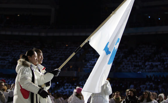 South Korea speed skater Bora Lee joined with Democratic People's Republic of Korea's figure skater Han Jong-In enter the Stadio Olimpico as they lead their delegation during the opening ceremony of the 2006 Winter Olympics.