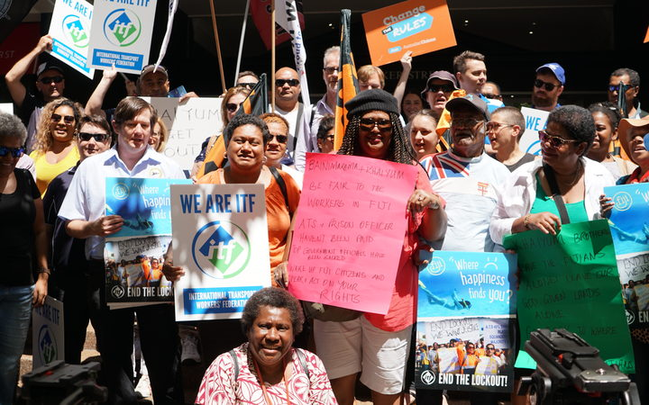 Australian unionists protesting outside Fiji's consulate in Sydney in support of Fijian airport workers.
