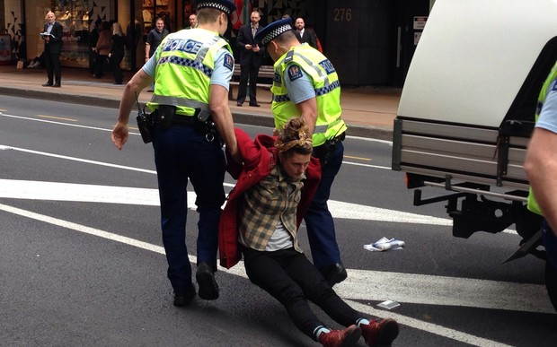 Police arrest protesters at the demonstration in Wellington