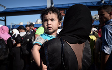 A Syrian child looks on after disembarking from a Greek government-chartered ferry taking refugees from smaller islands, including Leros, to Athens.