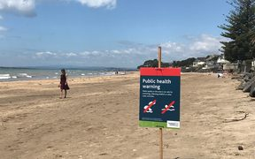 Milford Beach public health warning.