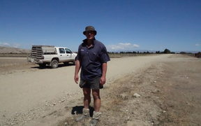 Farmer Andrew Paterson on his bone dry  farm near Omakau, Central Otago.