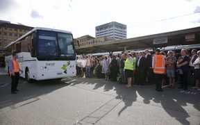Commuters wait for buses in Wellington.