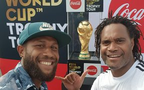 Solomon Islands National Football captain Henry Fa'arodo poses infront of the the FIFA World CUp Trophy with France's Christian Karembeu in Honiara, Solomon Islands. 01 February 2018