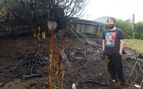 Daniel Davidson in his burned back yard.