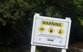 Signs warning people to stay out of the river went up in December