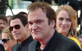 US director Quentin Tarantino arrives with actor John Travolta and Uma Thurman, pictured in 2014.