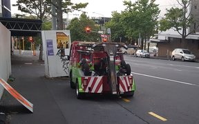 The two truck parked illegally on Cook St in central Auckland for about half an hour.