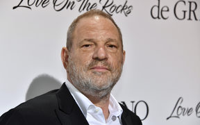 US film producer Harvey Weinstein poses for a photo at Cannes, shortly before news broke of his sexual misconduct.