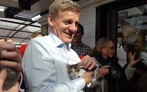 Bill English - and cat - on the campaign trail.
