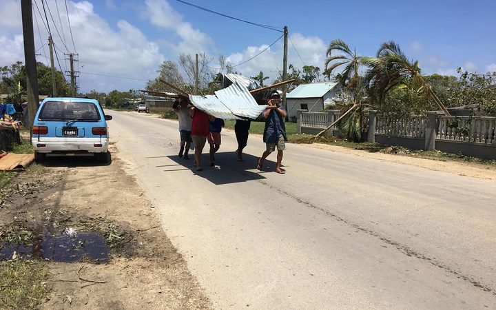 Tongans looking for material to rebuild.