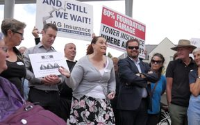 Residents with quake damaged homes protest thousands of unresolved  earthquake insurance claims.