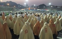 Prospective pilgrims walk to stone the devil during the first day of Eid Al Adha in Mecca.