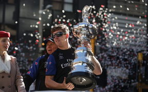 Peter Burling holds America's Cup after Team New Zealand won the event in Bermuda.
