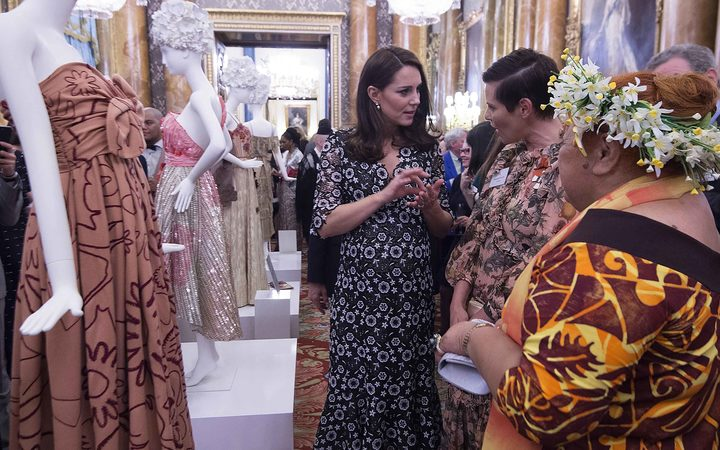 Duchess of Cambridge Kate Middleton (left), New Zealand designer Karen Walker (center) and Tukua Turia of the Cook Islands, speak during a reception to mark the creation of the Commonwealth Fashion Exchange initiative in Buckingham Palace.