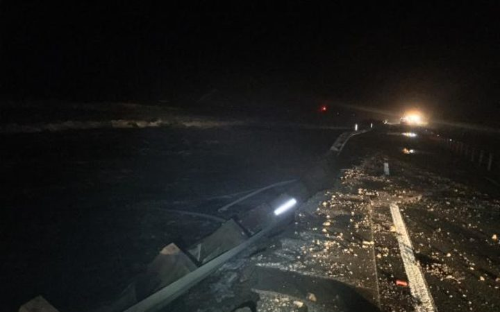 State Highway 1 is closed between Pukerua Bay and Paekakariki after sustaining damage. Waves washed over both lanes overnight.