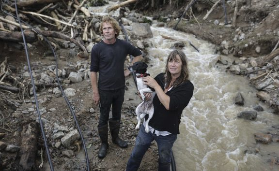 Barrytown was hit hard in former Tropical Cyclone Gita. Rita Bennett and her neighbour Mark Clisby repair a water pipe after a massive slip ripped through the property.