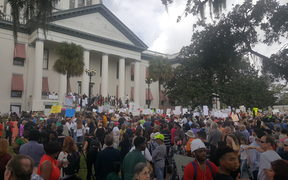 Students from Marjory Stoneman Douglas High School and supporters rally at Florida's Capitol in Tallahassee on Wednesday.