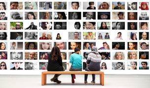 How do we re-shape our thinking around diversity. People watching many images of faces.