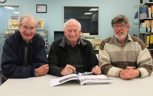 Dr Roger Frazer (left) shares his father's military history with Ian Grant of Fraser Books and Wairarapa archivist Neil Frances (right) who is writing a book on the tens of thousands of soldiers who marched over the Rimutaka Hill before embarking for the Western Front in the First World War.