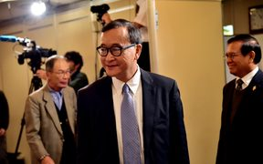 Cambodia's main opposition Cambodia National Rescue Party president Sam Rainsy arrives at a conference room to speak to the press in Tokyo.