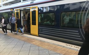 A crowded Auckland train as 'March madness', combined with a rail worker strike, begins.