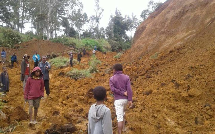 A landslide cutting of the tambul mendi road following a 7.5 earthquake.