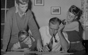 Mr M A Watts with his sons filling in census forms, 1956. Evening Post newspaper