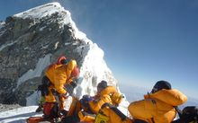 A group of mountaineers approach the Hillary Step in May 2009.