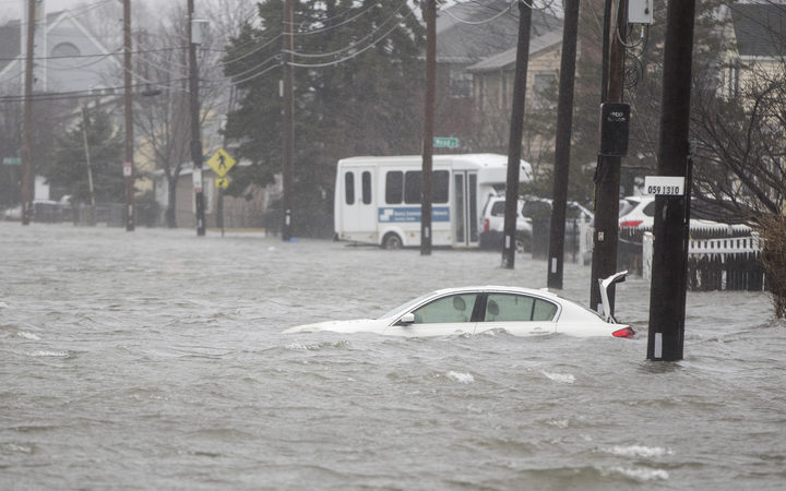 A flooded car sits in Hough's Neck due to a strong coastal storm on March 2, 2018 in Quincy, Massachusetts.