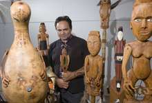 Artist James Webster with seven carved kareatao.