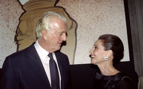 French designer Hubert de Givenchy and Audrey Hepburn talk together at the Galliera Museum in Paris during a reception honoring Givenchy for his 40 years in fashion.
