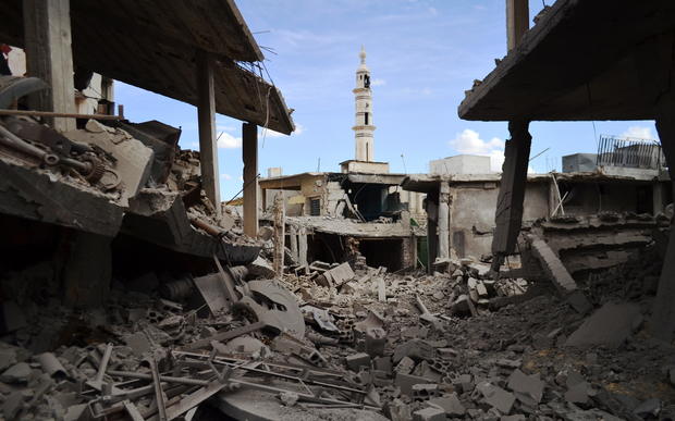 A picture taken on September 30, 2015 shows damaged buildings and a minaret in the central Syrian town of Talbisseh in the Homs province.