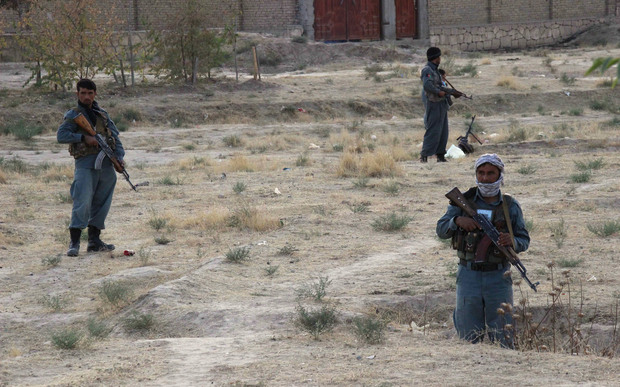 Afghan security personnel keeping watch as heavy fighting erupts near the airport on the outskirts of Kunduz.