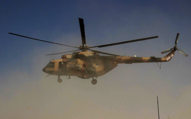 An Afghan helicopter carrying security personnel arrives at the scene of an offensive against Taliban insurgents in Kunduz on 30 September.
