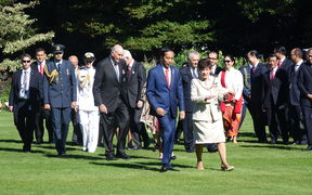 Indonesia's president Joko Widodo, centre, with Governor General Dame Patsy Reddy, arriving at Government House.