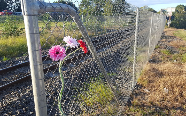 Flowers left near the site of a young girl's death on Ngaruawahia's rail bridge.