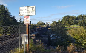 The danger signs at the rail bridge at Ngaruawahia.