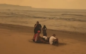 Tathra residents huddled on the beach to escape the destructive bushfire