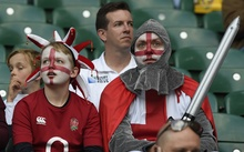 English rugby fans wait for the opening ceremony of the 2015 Rugby World Cup at Twickenham stadium in south west London on September 18, 2015.