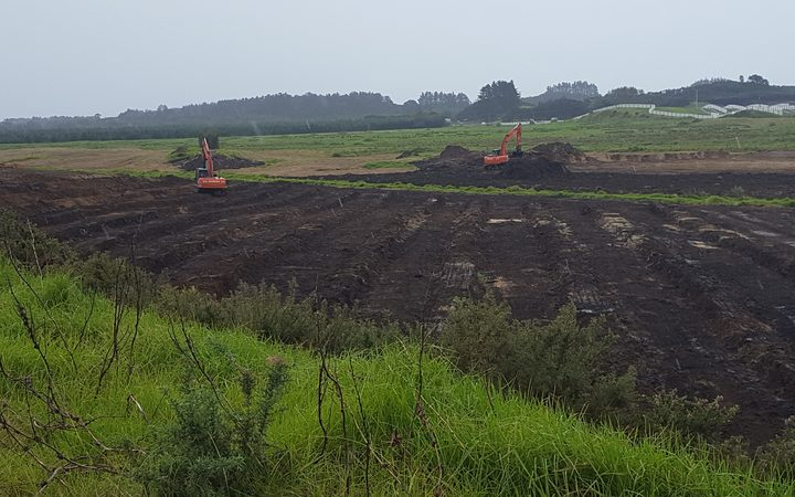 Diggers moving earth at Motutangi for new avocado orchards.