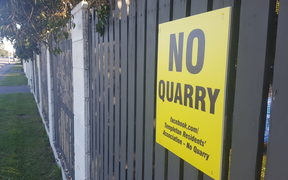 An anti-quarry sign in Templeton. Dozens are stuck on fences throughout the community.