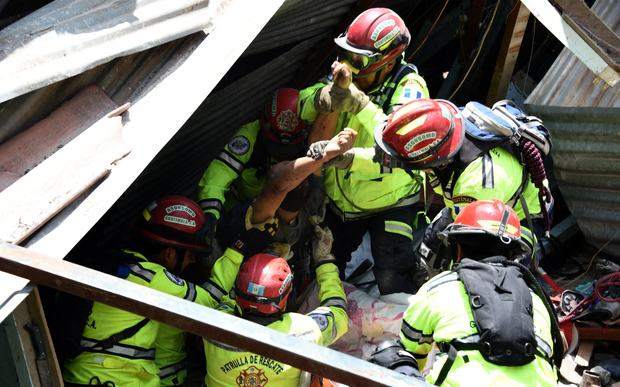 Rony Pu is rescued alive after a landslide at Cambray village