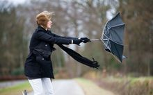 woman with umbrella blown inside out